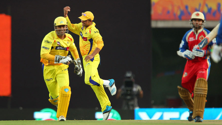 Suresh Raina and MS Dhoni celebrate the wicket of Parthiv Patel