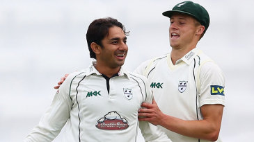 Saeed Ajmal celebrates a wicket with Alexei Kervezee