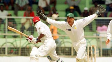 Moin Khan celebrates after Campbell is bowled by Saqlain