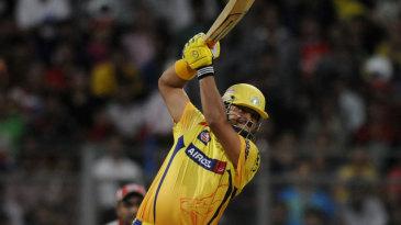 Suresh Raina blitzes the ball down the ground