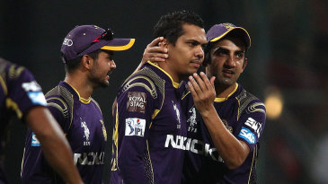 Gautam Gambhir congratulates Sunil Narine after he gets the wicket of George Bailey
