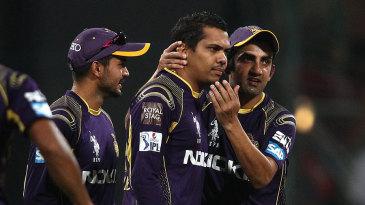 Gautam Gambhir congratulates Sunil Narine after he gets the wicket of George Bailey