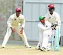 Marshall Ayub plays a sweep during his innings of 41, Sagicor HPC v Bangladesh A, Barbados, 2nd day, June 3, 2014