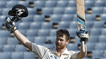 Jimmy Neesham celebrates his hundred