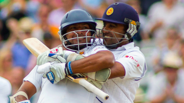 Kumar Sangakkara gets a hug from his mate Mahela Jayawardene