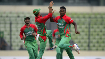 Al-Amin Hossain celebrates dismissing Akshar Patel with team-mates