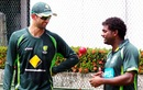 Muttiah Muralitharan gives Nathan Lyon some advice in Colombo, June 18, 2014