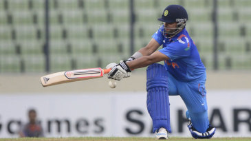 Suresh Raina sweeps during his 25