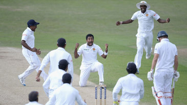 Dhammika Prasad shows his elation after trapping Gary Ballance first ball
