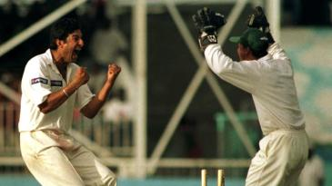 Wasim Akram celebrates the fall of Wavell Hinds' wicket