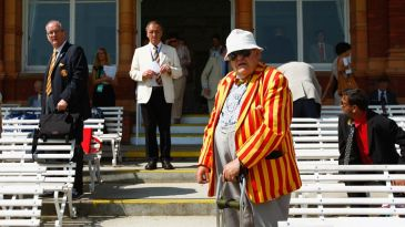 An MCC member in front of the pavilion at Lord's