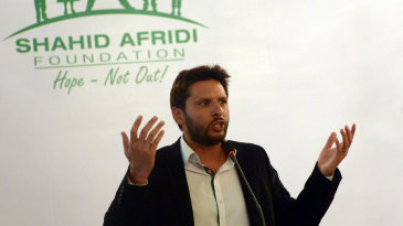 Shahid Afridi addresses the media during the launch of his charity foundation