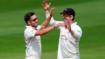 Simon Kerrigan celebrates a wicket with Steven Croft