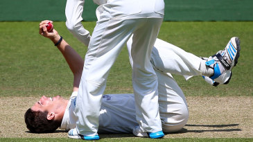 Putting his back into it: Steven Finn claimed a catch off his own bowling