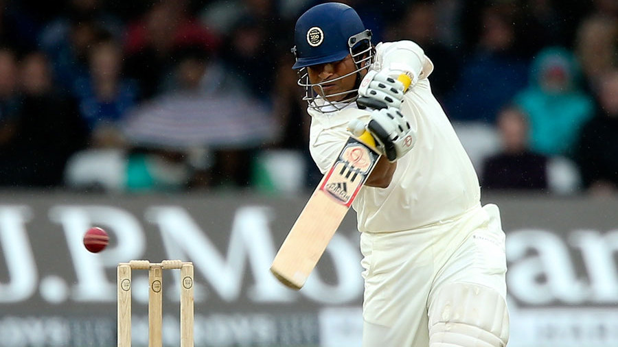 Sachin Tendulkar drives through the off side