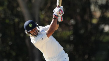 Manoj Tiwary plays a lofted shot down the ground