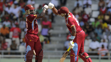 Andre Fletcher and Darren Sammy punch gloves