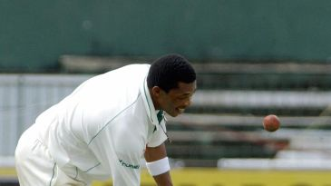 Makhaya Ntini pats Ashwell Prince on the back