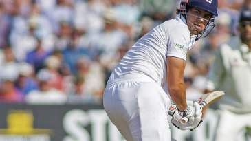 Alastair Cook turns around just in time to see his bails hit the ground