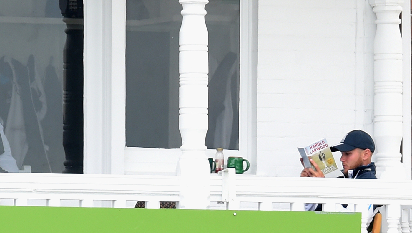 Stuart Broad tucks into a book on Harold Larwood
