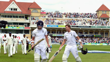 Joe Root and James Anderson leave the field for lunch