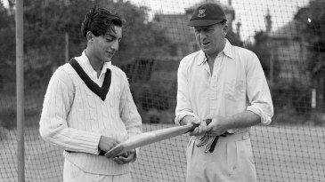 The Nawab of Patudi jr discusses a bat with former Sussex batsman George Cox