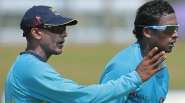 Ruwan Kalpage works with Ajantha Mendis during training