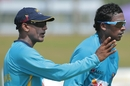 Ruwan Kalpage works with Ajantha Mendis during training, Galle, July 15, 2014