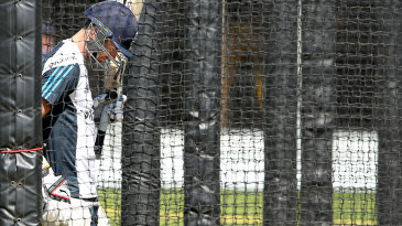 James Anderson walks in to bat at England's nets on the eve of the second Test