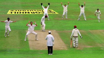 Andy Caddick celebrates the wicket of Ridley Jacobs