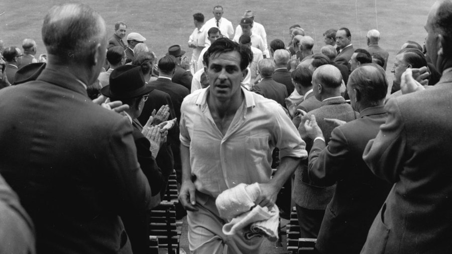 Fred Trueman walks back to the pavilion after becoming the first man to take 300 Test wickets