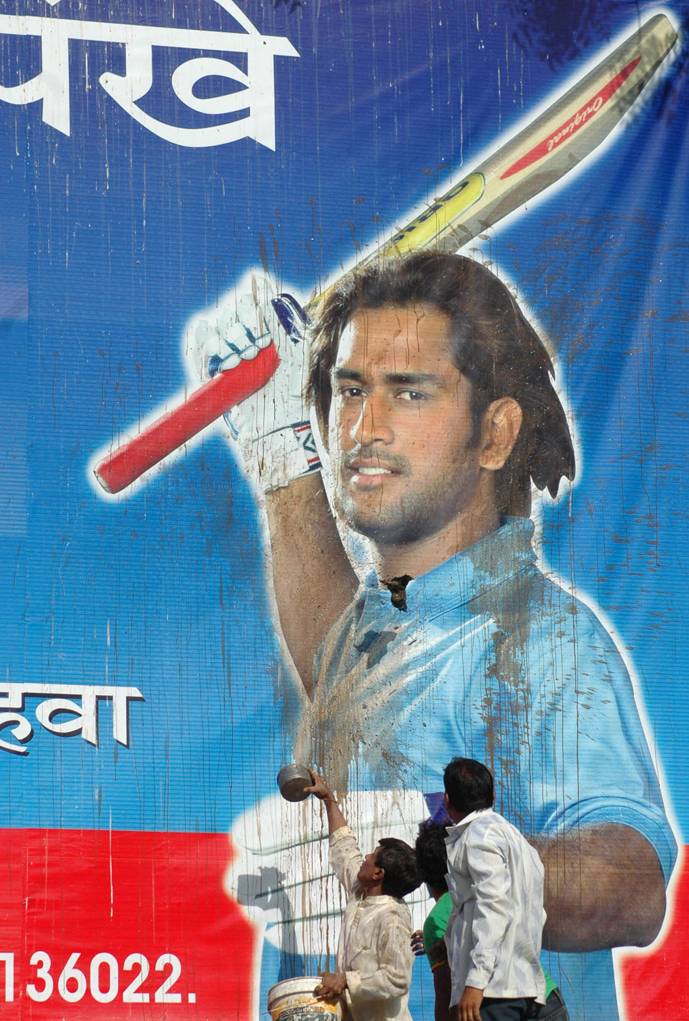 Protesters deface a poster after India's early exit in the 2007 World Cup. Dhoni said that was when he realised he couldn't afford to be defined by what happened on the field