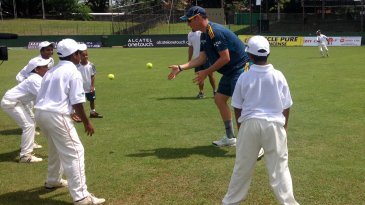 Kyle Abbott directs a fielding drill for Sri Lankan kids
