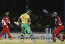Lendl Simmons looks back to see his stumps shattered, Trinidad & Tobago Red Steel v Guyana Amazon Warriors, CPL 2014, Port-of-Spain, July 24, 2014