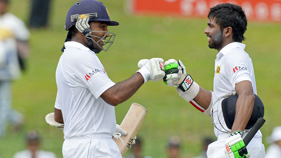 Mahela Jayawardene congratulates Niroshan Dickwella on his maiden fifty