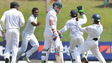 The Sri Lanka players celebrate the wicket of Dean Elgar