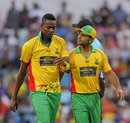 Mohammed Hafeez consults with Ronsford Beaton, Barbados Tridents v Guyana Amazon Warriors, CPL 2014, Bridgetown, July 26, 2014