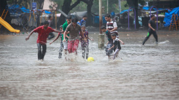 Football in the streets of water-logged Mumbai