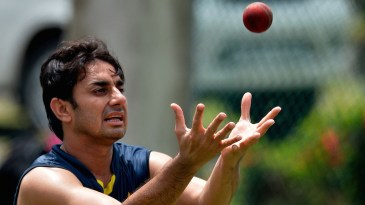 Grab the opportunity: Saeed Ajmal prepares to put his hands under the ball