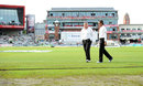 A wet outfield was the problem for umpires Marais Erasmus and Rod Tucker, England v India, 4th Test, Old Trafford, 2nd day, August 8, 2014