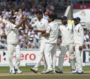 Pankaj Singh is congratulated after his first Test wicket, England v India, 4th Test, Old Trafford, 3rd day, August 9, 2014