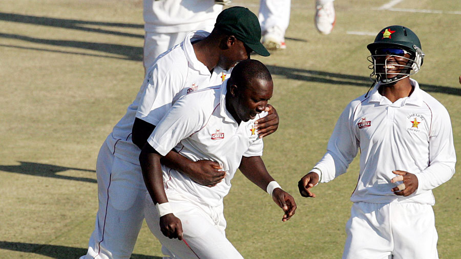 John Nyumbu and his team-mates celebrate the fall of AB de Villiers