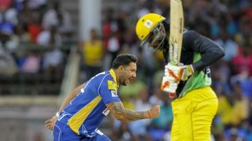 Ravi Rampaul celebrates after dismissing Chris Gayle lbw