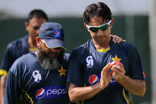 Mushtaq Ahmed has a word with Saeed Ajmal during training, Colombo, August 13, 2014
