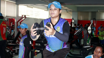 Jahanara Alam works out with a dumbbell