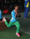 Lata Mondal stretches with a dumbbell, Mirpur, August 16, 2014