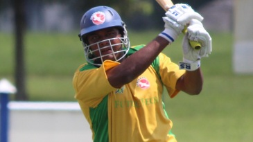 Aditya Thyagarajan completes a lofted drive over extra cover