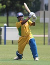 Aditya Thyagarajan completes a lofted drive over extra cover, North East v South West USACA T20 National Championship, Lauderhill, August 15, 2014