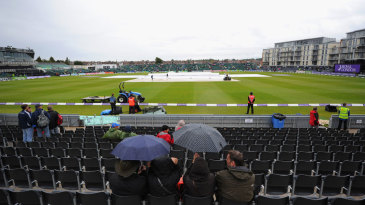 It was a morning for umbrellas as rain delayed the start