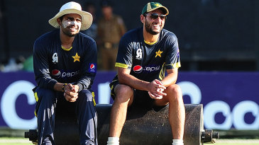 Umar Akmal and Shahid Afridi take a breather during Pakistan's practice session
